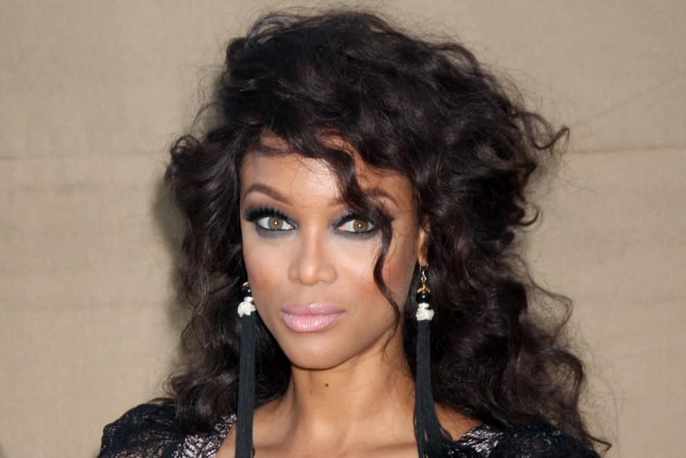 Tyra Banks was quite stylish with her black dress that she paired with her long and tousled raven curly hair with a slight half-up hairstyle when she arrived at the 2013 CBS TCA Summer Party at the private location on July 29, 2013 in Beverly Hills, CA.