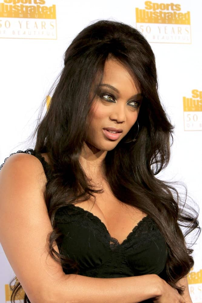 Tyra Banks had a long and wavy raven hair with a half-up beehive look at the 50th Sports Illustrated Swimsuit Issue at Dolby Theatre on January 14, 2014 in Los Angeles, CA.