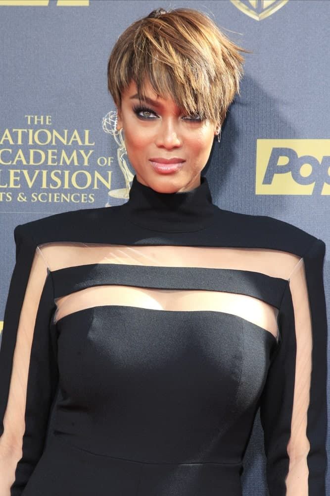 Tyra Banks cut her hair short into a pixie cut and styled it with highlights and a slight side-swept look at the 42nd Daytime Emmy Awards Gala at Warner Bros. Studio on April 26, 2015 in Burbank, California