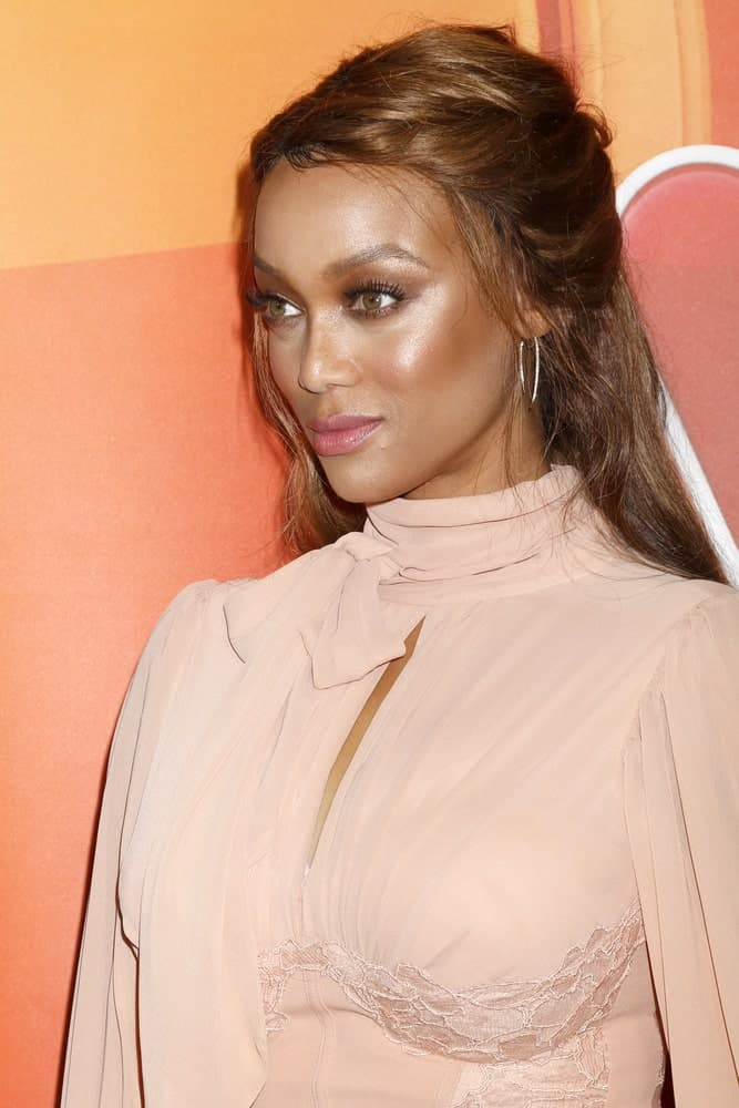 Tyra Banks' blush pink dress is a perfect pairing for brown dyed half up hairstyle at the NBC TCA Press Day Summer 2017 at the Beverly Hilton Hotel on August 3, 2017 in Beverly Hills, CA.