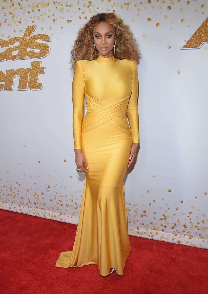Tyra Banks was the picture of elegance in her long yellow dress and tousled brown curls when she arrived at the'America's Got Talent' Live Show Screening and Red Carpet on August 14, 2018 in Hollywood, CA.