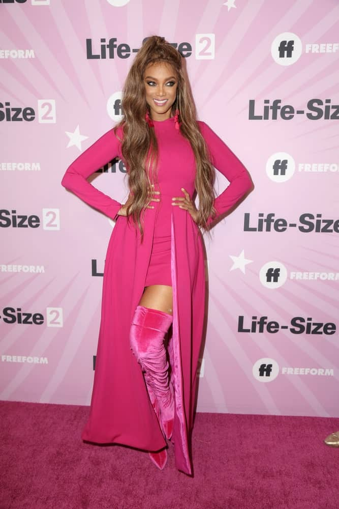 Tyra Banks was quite fashionable in her pink outfit and long brown dyed hair in a high ponytail at the