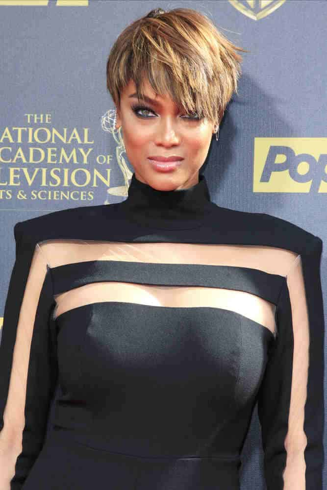 Tyra Banks rocks a funky layered pixie hairstyle during the 42nd Daytime Emmy Awards Gala on April 26, 2015.