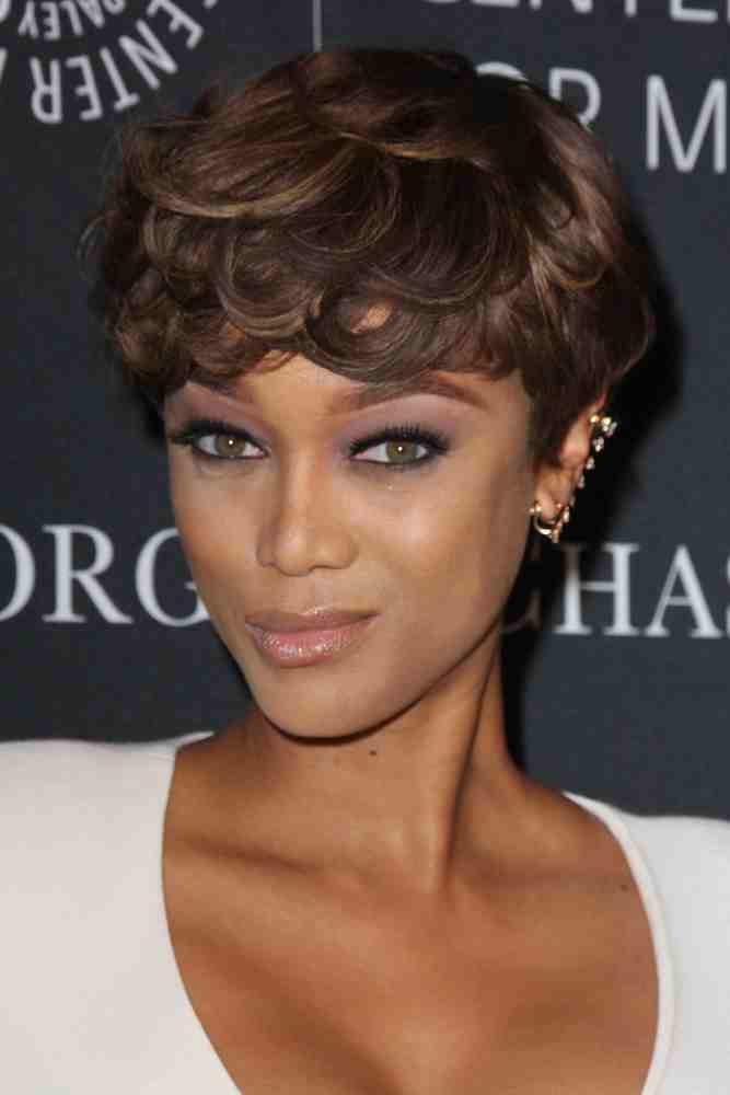 Tyra Banks looks lovely in this curly pixie locks hairstyle at the Paley Center's Hollywood Tribute to African-Americans in TV event on October 26, 2015.