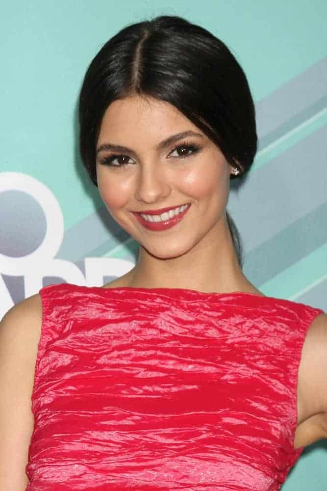 Victoria Justice wore a bright red dress at the 2011 Nickelodeon TeenNick HALO Awards at Hollywood Palladium on October 26, 2011, in Los Angeles, CA. She paired this with a slick raven ponytail hairstyle.