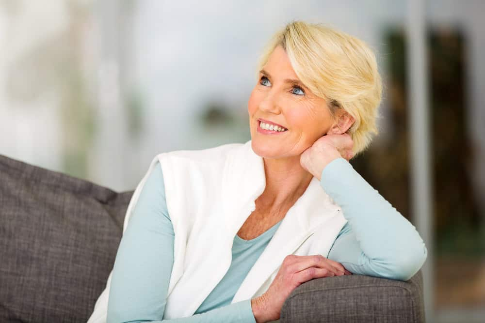 Woman over 50 with short blonde hair.