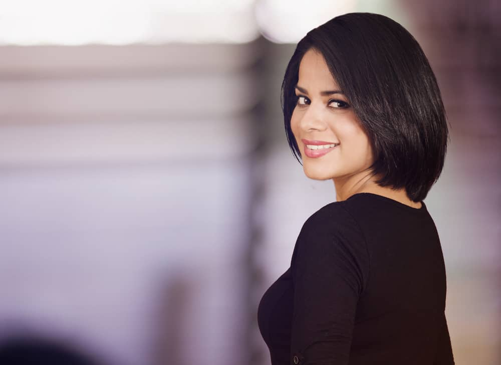 Woman with thick, dark hair in bob style