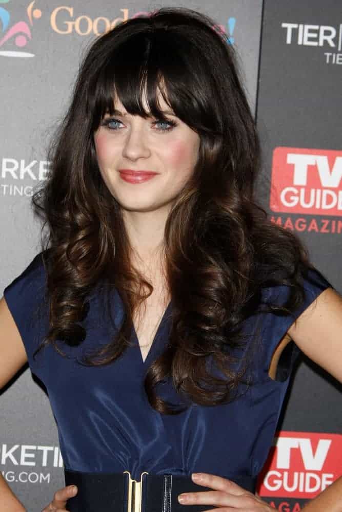 Zooey Deschanel attended the TV Guide Magazine Hot List Party at the Greystone Manor on November 7, 2011, in Los Angeles, CA. She wore a charming blue dress with her long and tousled dark hairstyle that has spiral curls and layers.