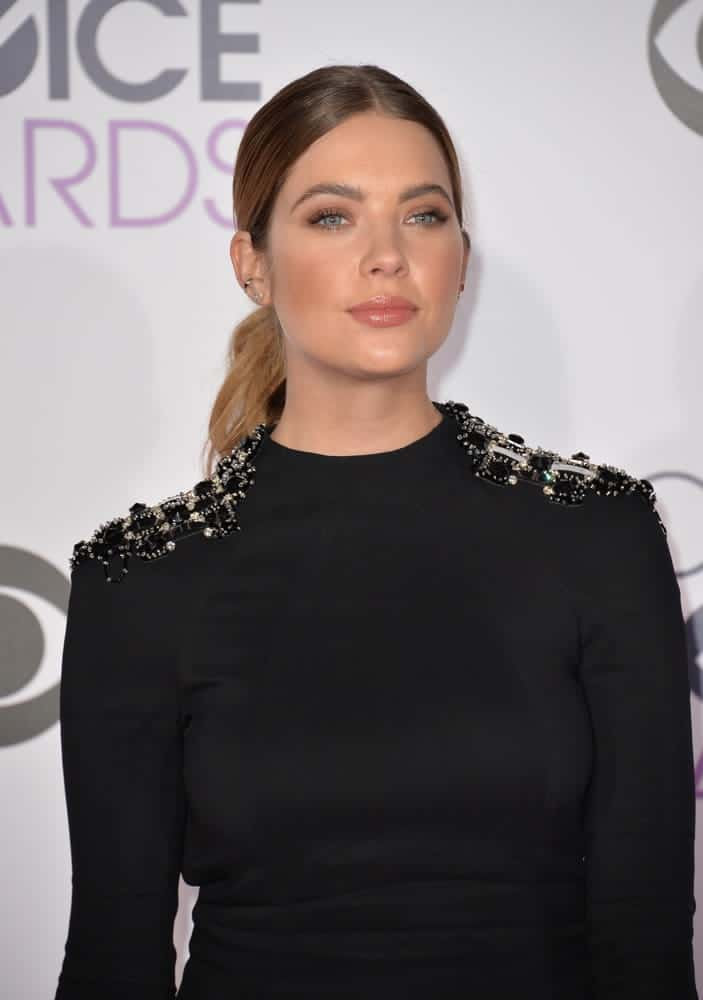 Ashley Benson wears a classic low middle-part ponytail at the People's Choice Awards 2016 on January 6, 2016.