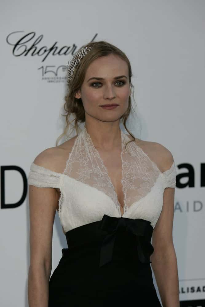The German-American actress looks adorable in a messy up-do with a diamond leaf accessory in it at the AMFAR Cinema Against Aids Gala on May 20, 2010.