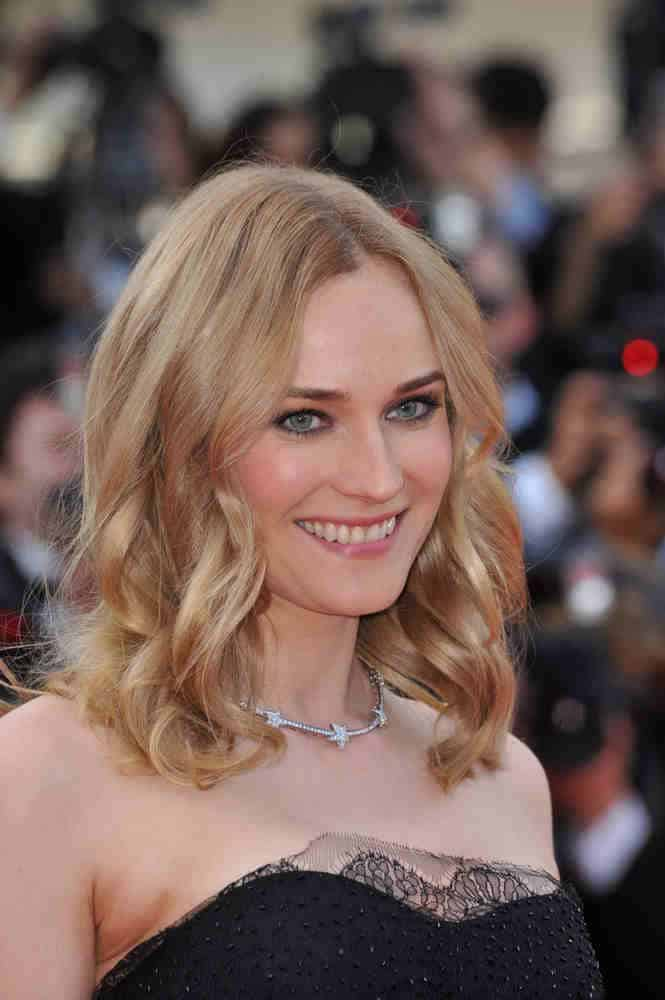 The German-American beauty showed some charm with her loose beachy waves for her medium-length locks at the 63rd closing Awards Gala on May 23, 2010.