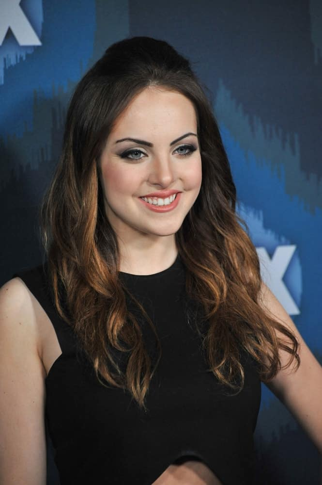Elizabeth Gillies's teased crown half up half down hairstyle leave a vintage feel at the Fox Winter TCA 2015 All-Star Party on January 17, 2015.