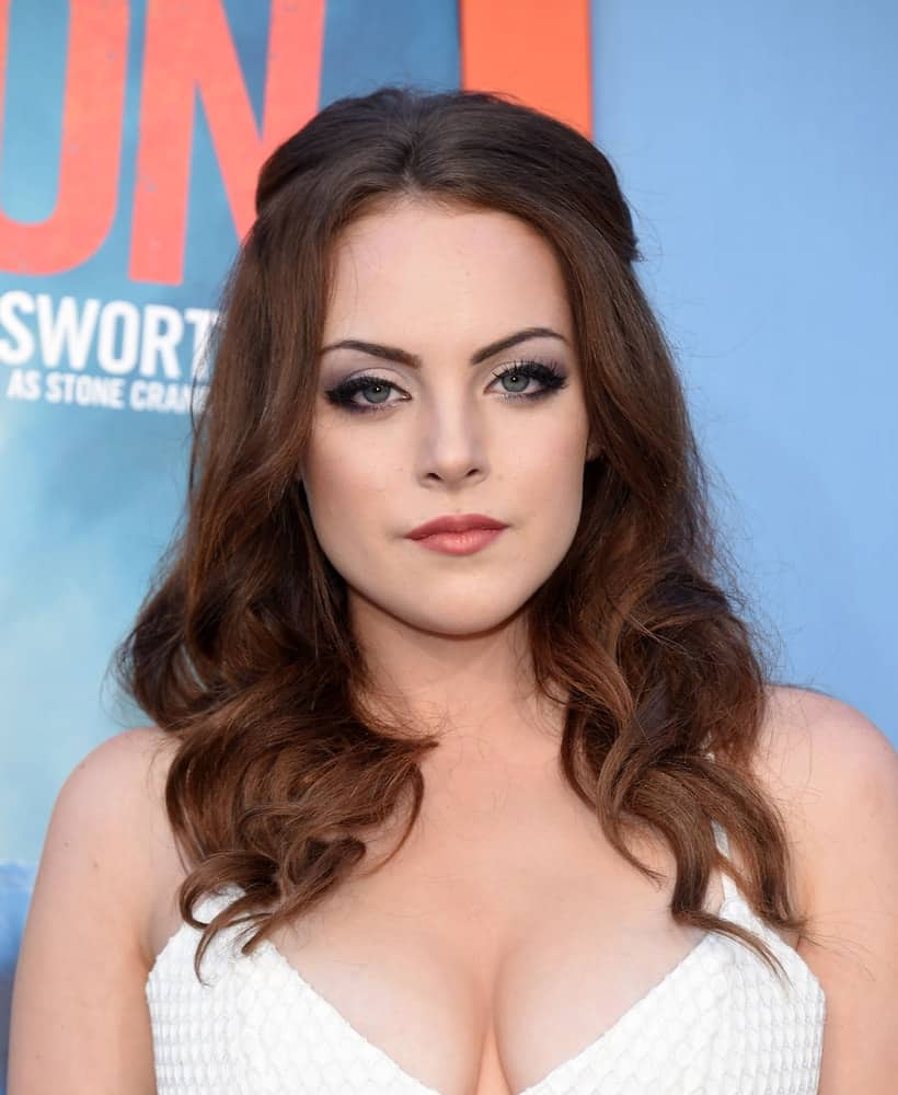 Elizabeth Gillies oozed retro charm with her middle-parted half-up 'do at the