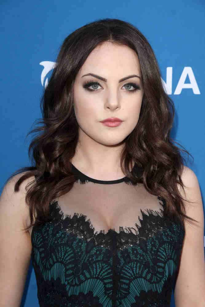 Elizabeth Gillies topped off her elegant look with big loose curls at the