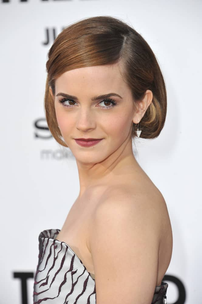 Emma Watson with short, side part hairstyle.