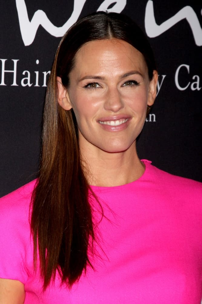 She paired her fuchsia frock with a simple straight 'do, swept to the side at the Pink Party 2014 on October 18, 2014.