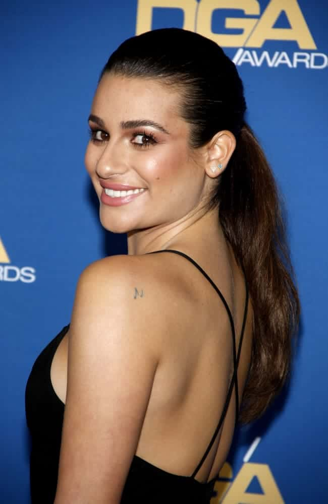 Lea Michele went casual with this slicked back low ponytail hairstyle at the Hyatt Regency Century Plaza on February 7, 2015.