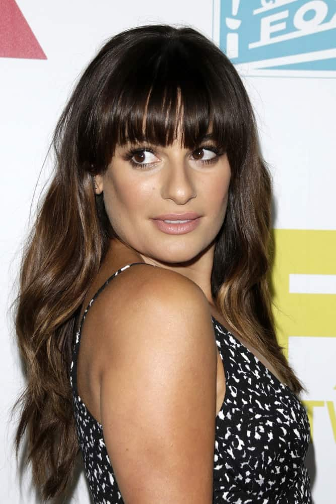 Lea Michele looks so adorable in this wavy loose hairstyle with blunt bangs at the 20th Century Fox Party Comic-Con Party on July 10, 2015.