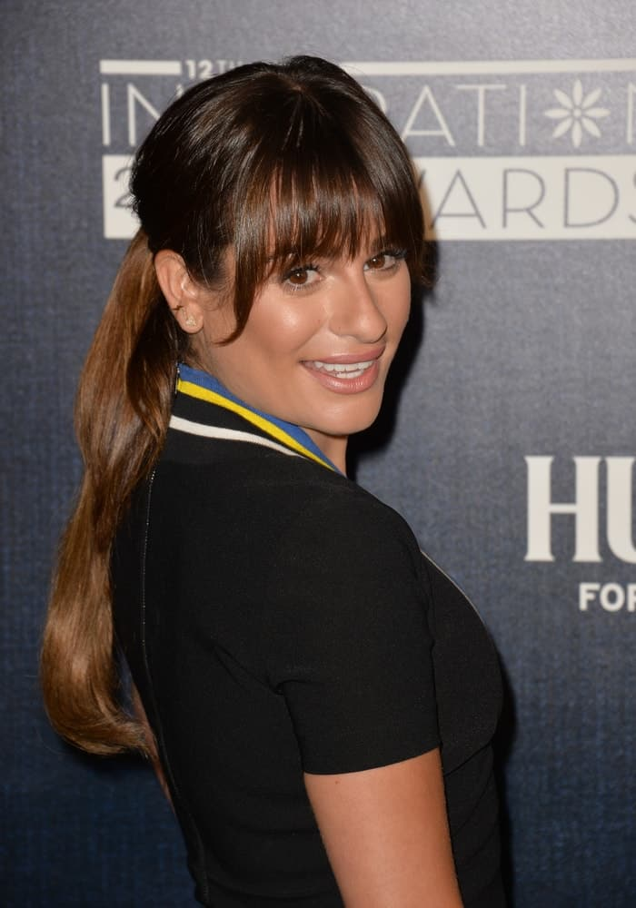 Lea Michele pulled her long brunette hair back into a low ponytail with blunt bangs at the Step Up Women's Network 12th Annual Inspiration Awards on June 5, 2015.