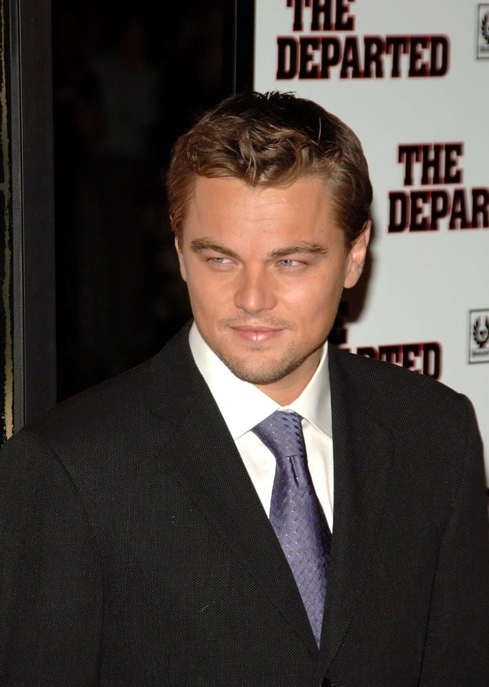 Leonardo DiCaprio dazzles in a very short hairdo with mussed-up locks at the front for the 2006 premiere of his movie