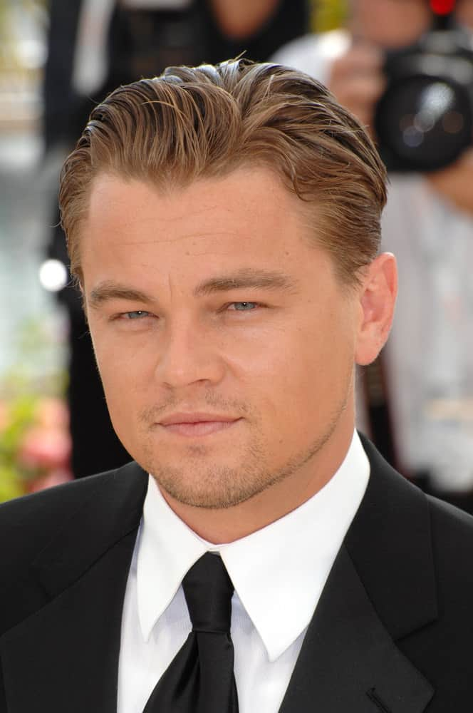 Leonardo DiCaprio's short wavy locks are swooped back in style as he attends the photocall for his movie