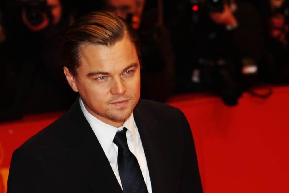 Leonardo DiCaprio looks suave in his slick, side swept 'do as he attends the
