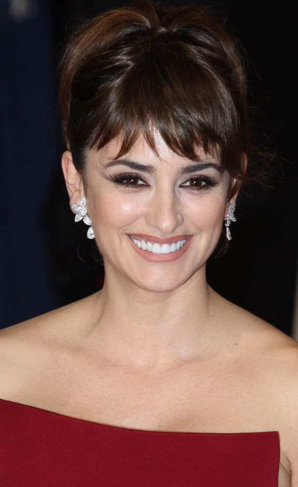 The actress has brought the swingin' sixties with her high ponytail with short wispy bangs at the Orange sponsored 65th British Academy Film Awards on February, 12, 2012.