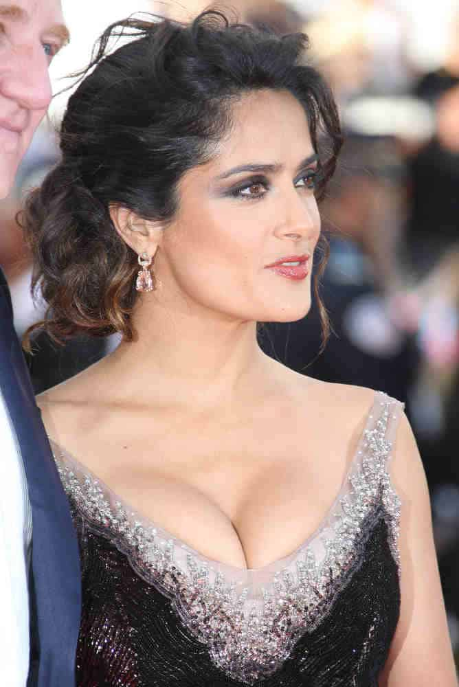 Salma Hayek sported a messy upstyle with long side bangs as she arrives for the 'Madagascar 3' premiere on May 18, 2012.