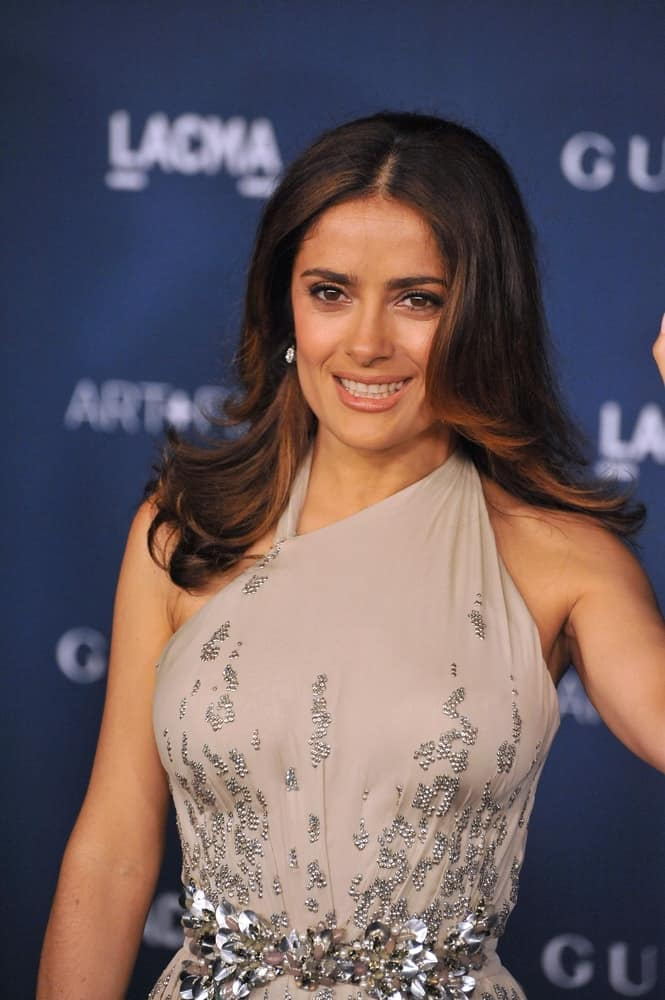 Salma always looked fresh and young especially with her loose flipping mane with a dramatic center part at the 2013 LACMA Art+Film Gala on November 2, 2013.