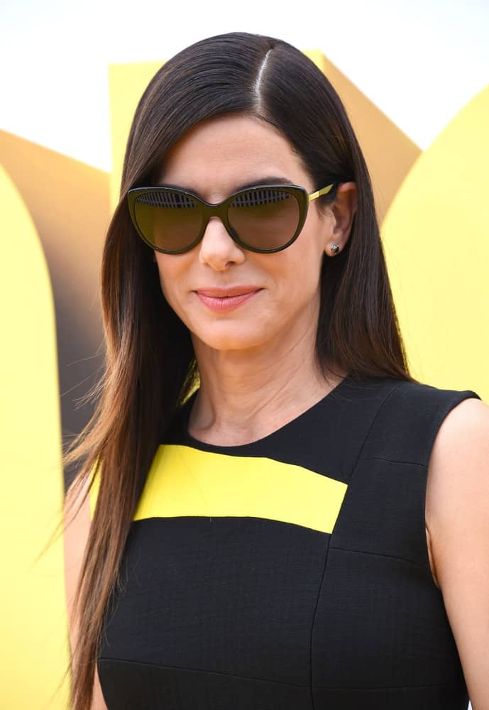 Sandra Bullock was fresh-faced wearing her hair pin-straight with a side part as she arrives to the