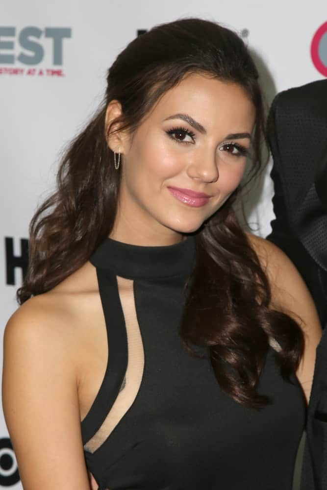 "Victoria Justice's curly half up half down hairstyle captivated at the ""Naomi & Ely's No Kiss List"" Screening on July 17, 2015."