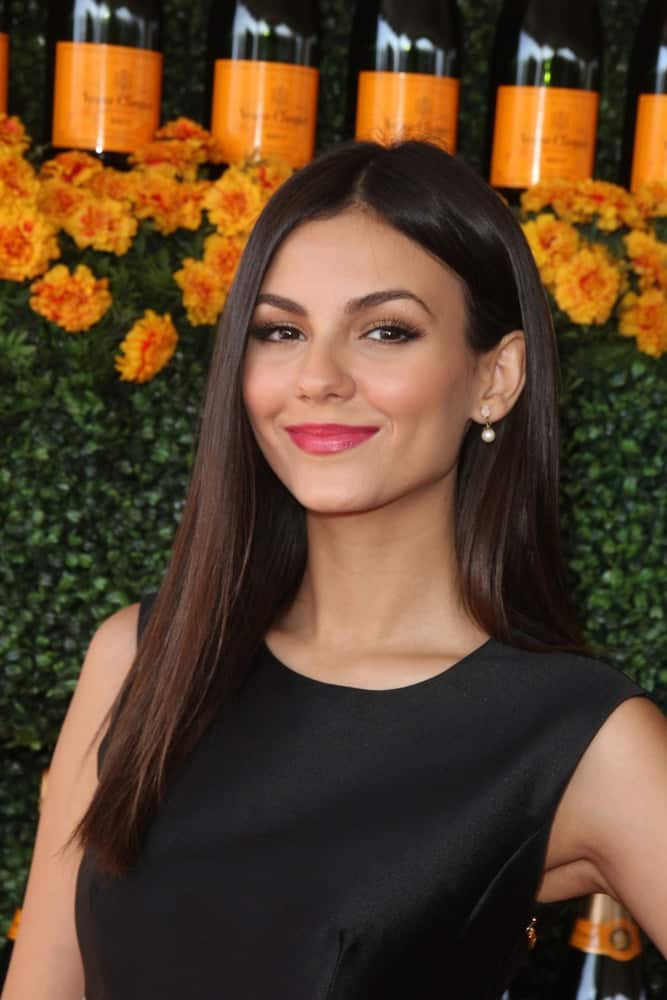 Victoria Justice paired her BOHO look with a simple middle-parted straight loose hairstyle at the Sixth-Annual Veuve Clicquot Polo Classic on October 17, 2015.