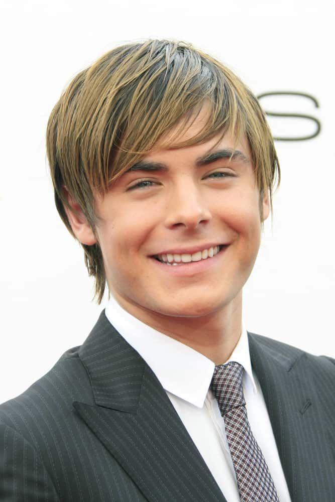"Zac Efron attended the premiere of his movie ""Hairspray"" on July 10, 2007 sporting a short haircut with acicular texture."