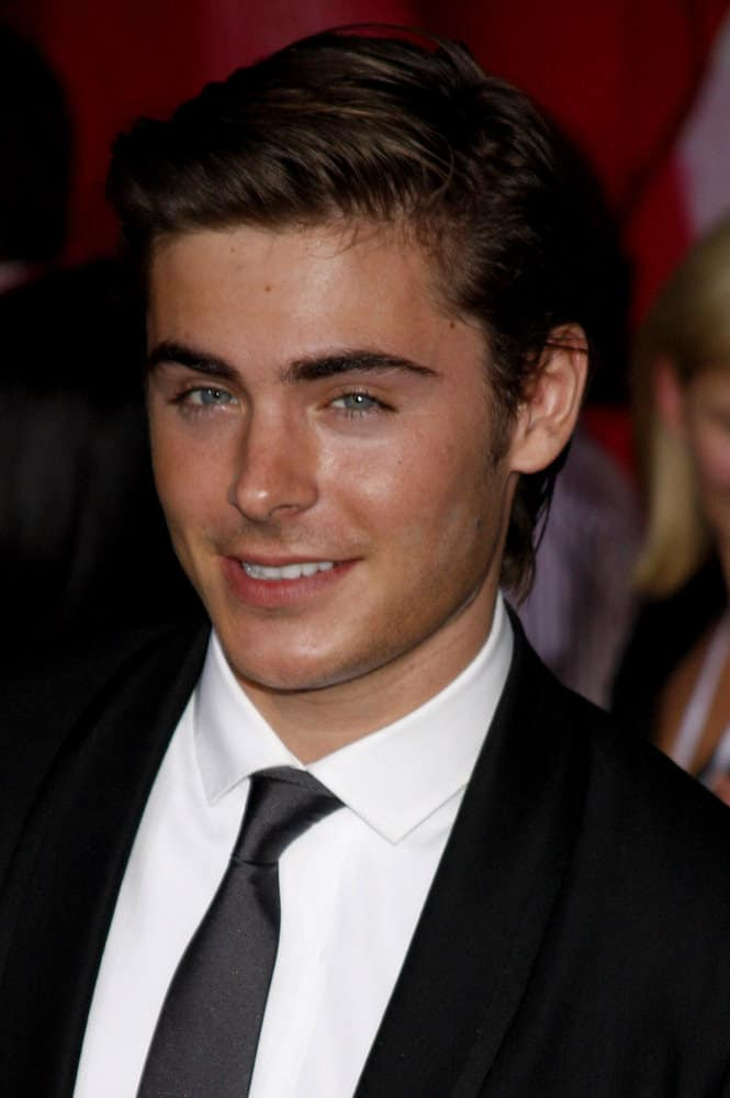 Zac Efron looks suave with slick, side-swept hairstyle at the Los Angeles Premiere of 'High School Musical 3: Senior Year' held at the Galen Center in Los Angeles, USA on October 16, 2008.