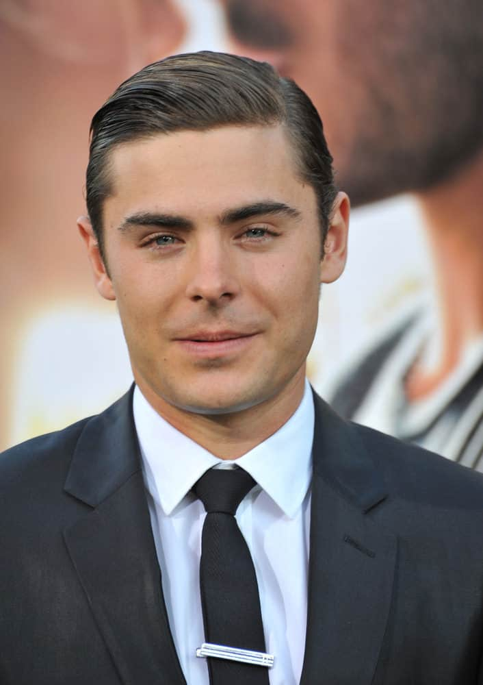 "Zac Efron glams up with a slick, side-swept look at the world premiere of his movie ""The Lucky One"" on April 16, 2012."