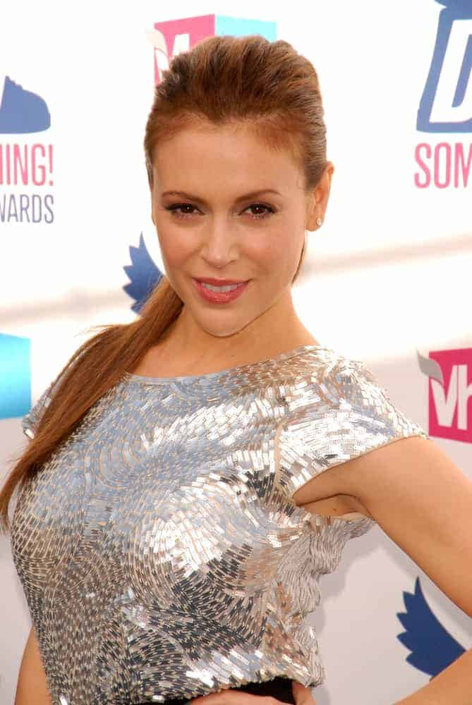 Alyssa Milano modeled her chic slicked back pony at the VH1 2010 Do Something Awards on July 19, 2010. She completed the gorgeous look with a shining silver dress.