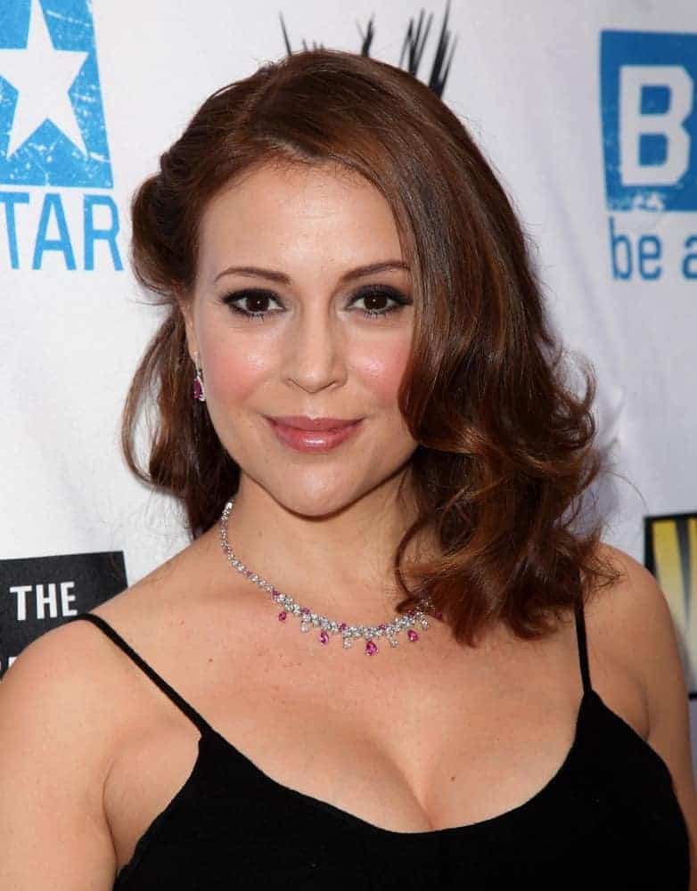 Alyssa Milano's auburn mane was styled with side pinned half and some big loose curls to one side for Anti-Bullying Alliance Launch on April 29, 2010. She wore a matching necklace and earrings along with a black spaghetti dress.