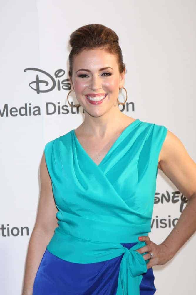 This celeb is wearing a classic pompadour bun at the ABC / Disney International Upfronts on May 20, 2012. She paired it with hoop earrings and a two-toned wrap around dress.