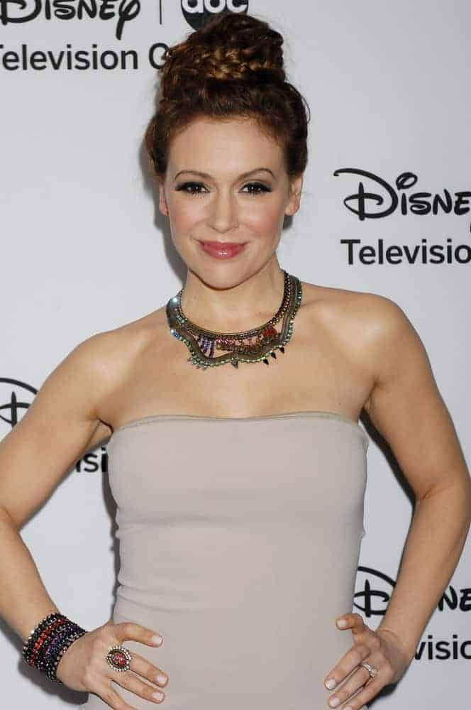 This halo braided top knot looks sexy for auburn mane like this lovely celeb wore at the 2013 Disney ABC Television Group TCA Winter Press Tour on January 10, 2013.