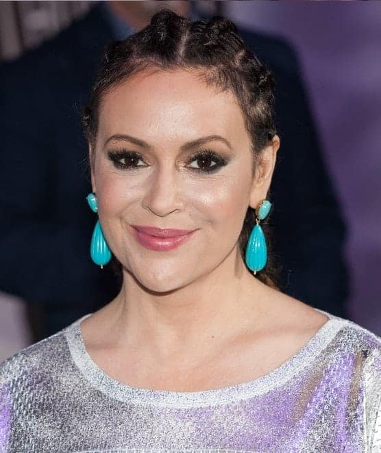 Actress Alyssa Milano attended the 26th annual Taste of the NFL Party with a Purpose at the University of Houston on February 4th 2016. She wore a braided upstyle incorporated with blue dangling earrings.