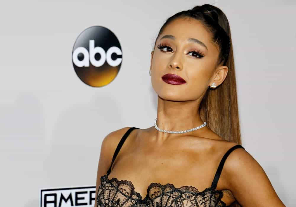 Pop singer Ariana Grande put her signature ponytail to the next level as she attends the 2016 American Music Awards held on November 20, 2016. She wore an ultra-long ponytail with tiny braids on top and sides that added tons of texture to her look.