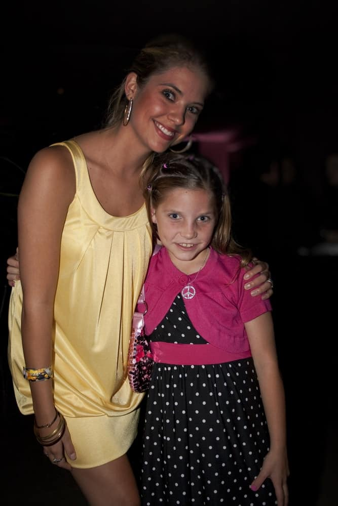 Ashley Benson attended the 3rd annual Evening with the Stars prior to the 62nd annual Mother Goose Parade on November 22, 2008 in San Diego, CA. She posed with a fan wearing a yellow dress to pair with her neat sandy blonde ponytail.