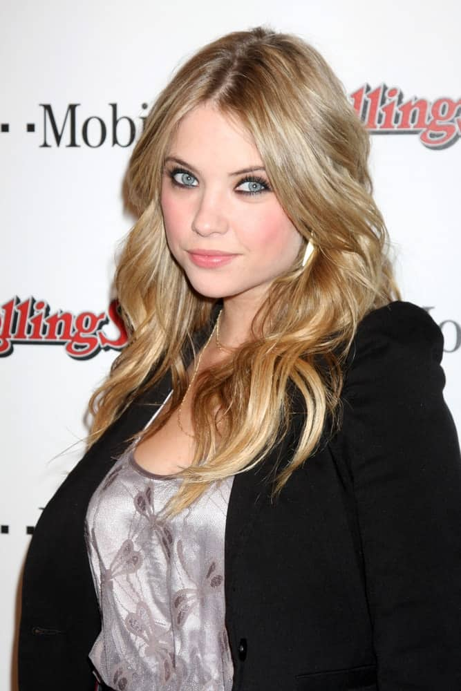 Ashley Benson was at the Rolling Stone Pre-Oscar Bash 2011 at W Hotel on February 26, 2011 in Hollywood, CA. She wore a smart casual outfit and black jacket to pair with her long, wavy and layered sandy blonde hairstyle with highlights and a tousle.