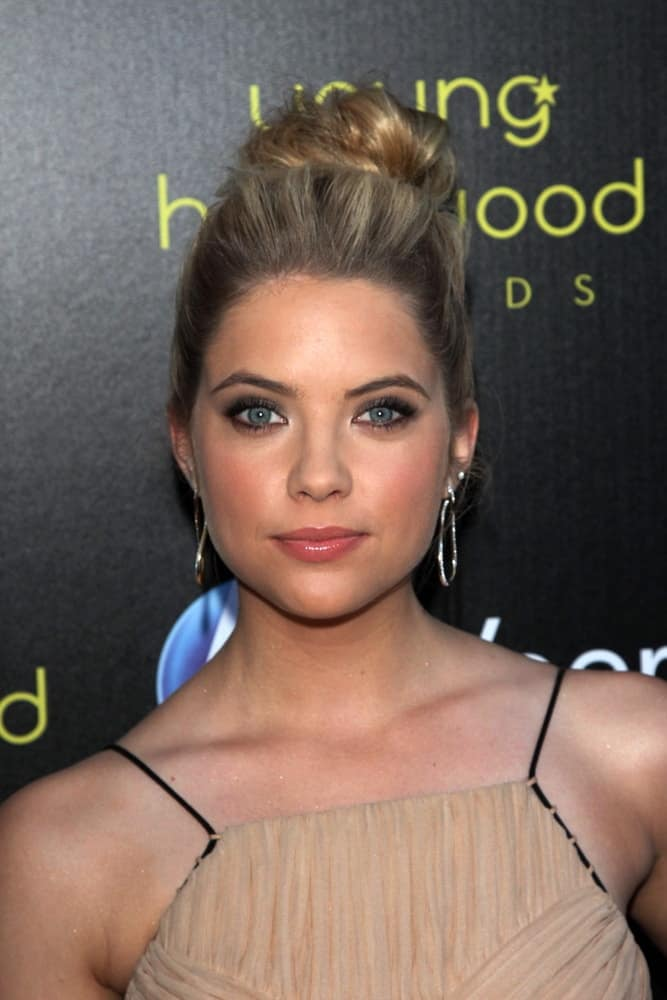 Ashley Benson was at the 2011 Young Hollywood Awards, Club Nokia, Los Angeles, CA on May 20, 2011. She wore a beige dress that complemented her highlighted top knot bun hairstyle.
