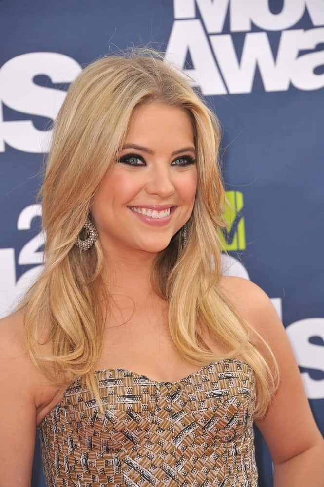 Ashley Benson was at the 2011 MTV Movie Awards at the Gibson Amphitheatre, Universal Studios, Hollywood on June 5, 2011. Her patterned beige dress pairs well with her smooth layered sandy blonde hair styled into a long, loose and tousled look.
