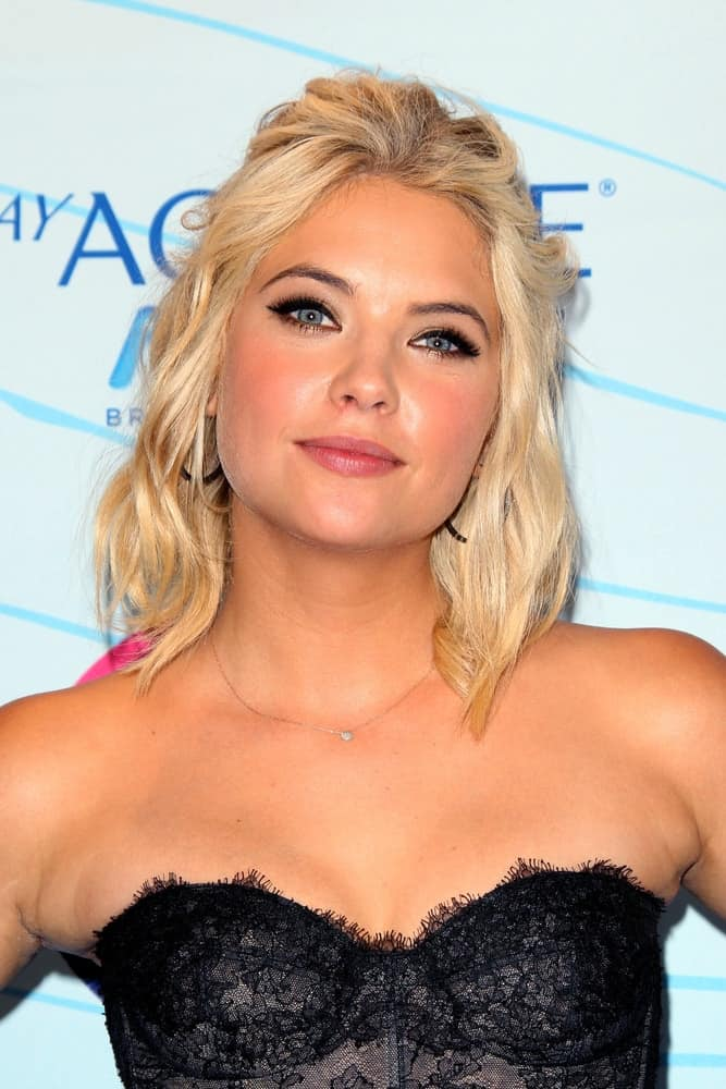 Ashley Benson was at the Press Room of the 2012 Teen Choice Awards at Gibson Ampitheatre on July 22, 2012 in Los Angeles, CA. She was stunning in her strapless black corset top and a shoulder-length blonde half-up hairstyle with waves and a tousled finish.