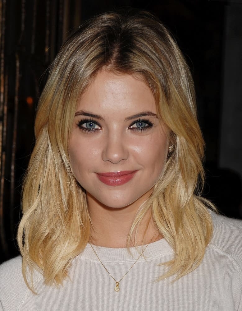 Ashley Benson arrived at the Monika Chiang Store One Year Anniversary Party on December 5, 2012 in Los Angeles, CA. She wore a white sweater to go with her loose and layered shoulder-length blonde hairstyle with subtle waves.