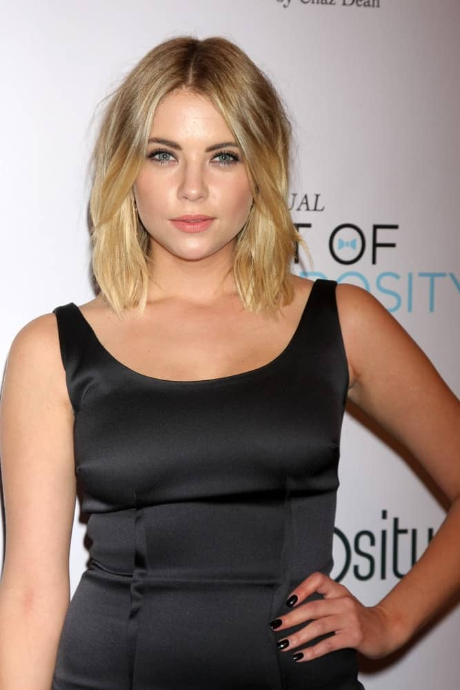 Ashley Benson wore a black dress at the 6th Annual Night Of Generosity at the Beverly Wilshire Hotel on December 5, 2014 in Beverly Hills, CA. She paired this with a shoulder-length wavy layered blonde hairstyle with highlights.