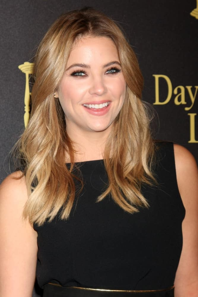 Ashley Benson flashed a lovely smile at the Days of Our Lives 50th Anniversary Party at the Hollywood Palladium on November 7, 2015 in Los Angeles, CA. She came wearing a black dress with her sandy blonde loose and tousled hairstyle with subtle waves and layers.