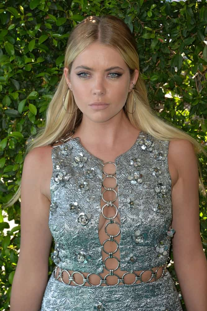 On July 31, 2016, actress Ashley Benson was at the 2016 Teen Choice Awards at The Forum in Inglewood, California. She wore a stunning bejeweled dress with her long balayage sandy blonde half-up hairstyle.